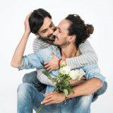 man embracing man affectionately